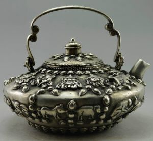 Not only do these tea pots have the eight auspicious Buddhist symbols, but the 12 zodiac animals encircle the lower half as well. Very auspicious!