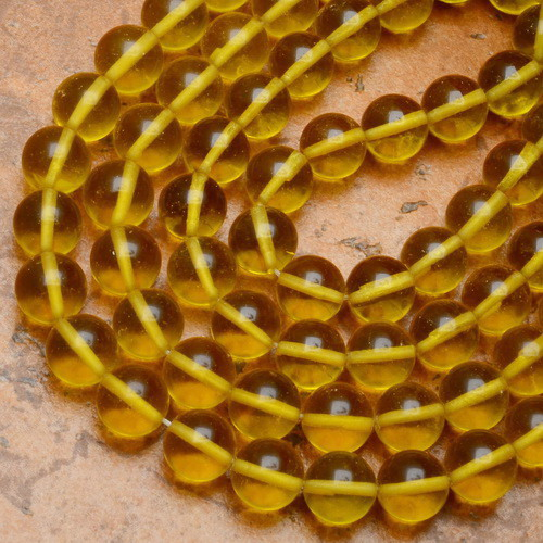 Citrine (colored quartz) probably from Buddhist malas, being sold as