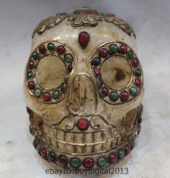 Tibetan Quartz Crystal Skull with rubies and emeralds