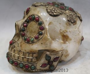 Tibetan Quartz Crystal Skull with rubies and emeralds