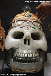 Sacred Gold, Turquoise and Coral Tibetan Crystal Skull being sold by Chinese Communists