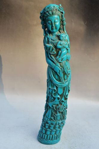 Imitation turquoise (resin) carved in the classic shape of a elephant tusk.