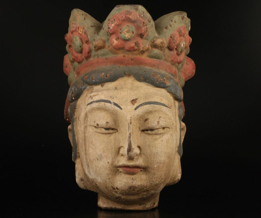 Early wooden head. Not sure if it originally came from a full statue and the head is all that remains?