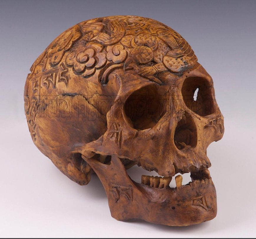 I found this old gal (guy?) being sold as a resin replica of a real kapala. I'm not so sure it isn't real given the look of the carving and the color of the material, as well as the fact that its missing some teeth. Looks VERY real to me.